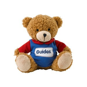 Guides teddy bear wearing uniform with logo